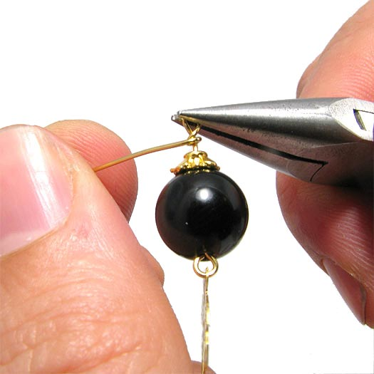 Perlevedhæng med øje