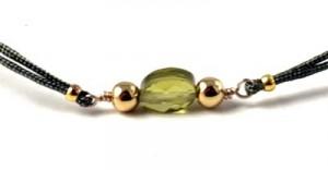 zirkon og forgyldte perler på armbånd
